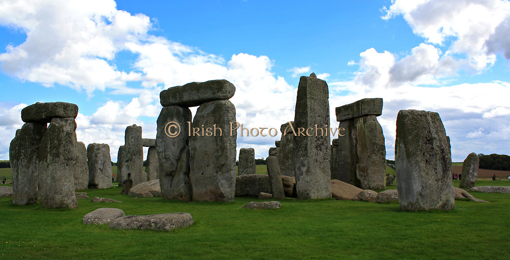 Stonehenge is a prehistoric monument located in the English county of Wiltshire, one of the most famous sites in the world.  It is composed of earthworks surrounding a circular setting of large standing stones.  It is the centre of the most dense complex of Neolithic and Bronze Age monuments in England, including several hundred burial mounts.