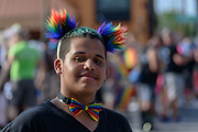 Tyrest Whitaker, 15.<br /> The Lesbian, Gay, Bisexual, Transgender, and Queer (LGBTQ) community and their friends, family and supporters walked and lined Main Street from Floyd Street to the Belvedere for the Kentuckiana Pride Parade, Saturday, June 16, 2017 in Louisville, Ky. (Photo by Brian Bohannon)