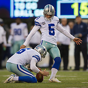 Oct 25, 2015; East Rutherford, NJ, USA;Dallas Cowboys kicker Dan Bailey (5) kicks extra point with Dallas Cowboys punter Chris Jones (6) holding in the 2nd quarter at MetLife Stadium. Mandatory Credit: William Hauser-USA TODAY Sports