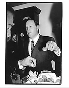 Stephen Brill eating canape. NY. 1994 approx. © Copyright Photograph by Dafydd Jones 66 Stockwell Park Rd. London SW9 0DA Tel 020 7733 0108 www.dafjones.com