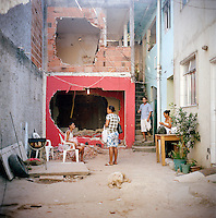 Residents of Largo do Tanque undergo forced evictions and demolition of homes in Rio de Janeiro's West Zone, to make room for the Transcarioca Highway, that will eventually be built to accommodate the Olympics, in Rio de Janeiro, Brazil, on Monday, Feb. 25, 2013. <br /> <br /> In less than 2 weeks, 54 houses were demolished with sledgehammers and bulldozers. In under 2 weeks, 54 houses were demolished and hundreds of residents left to fend for themselves. The City assessor sent to handle negotiations told residents not to speak with one another or seek legal advice otherwise he would reduce settlement offers. Many residents agreed to compensations, around R$7000 (US$3500). Most residents cannot afford to buy a plot of land with that compensation and will be forced to rent kitchenettes, at less than 20m2. As established in the Brazilian Constitution, and in accordance with local legislation (the Organic Municipal Law), the duration of residents' life in the area gave them legal rights to the homes, while compensation should allow them to attain an equal situation elsewhere. <br /> <br /> The west zone, located west of downtown and beach neighborhoods is often overlooked and is widely known to be run by militia groups, who are former and current police and firefighter personnel that run extortion rings to monopolies.