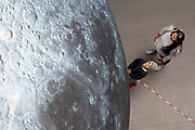 17/07/2018 repro free:  People  at Luke Jerram&rsquo;s Museum of the Moon measuring seven metres in diameter and featuring 120dpi detailed NASA imagery of the lunar surface pictured in  Human Biology Building, NUI Galway as part of Galway International Arts Festival. Museum of the Moon is a new touring artwork by UK artist Luke Jerram who is known worldwide for his large scale public artworks.  The installation is a fusion of lunar imagery, moonlight and surround sound composition created by BAFTA and Ivor Novello award winning composer Dan Jones. GIAF runs from 16 &ndash; 29 July www.giaf.ie<br />   .Photo:Andrew Downes, XPOSURE