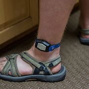 ROCKVILLE, MD - JUL25: John Bucknam, 18, has autism, wears a tracking device on his ankle so he can be found in case he wanders away from home. The Bucknam's have a series of locks on their doors to keep John from wandering off. (Photo by Evelyn Hockstein/For The Washington Post)