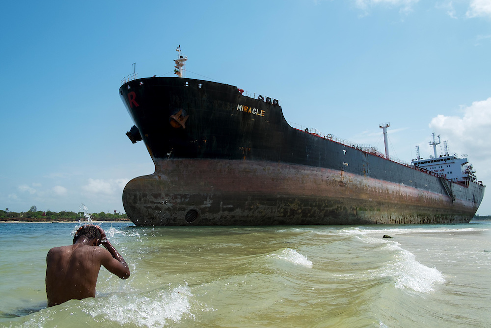 Dar es Salaam, Tanzania - 13.02.16  - Ramadani takes a bath in the Indian Ocean near the Marshall Islands flagged tanker vessel 'Miracle' after it ran aground at the mouth of the Dar es Salaam harbour on Saturday, February 13, 2016. Photo by Daniel Hayduk