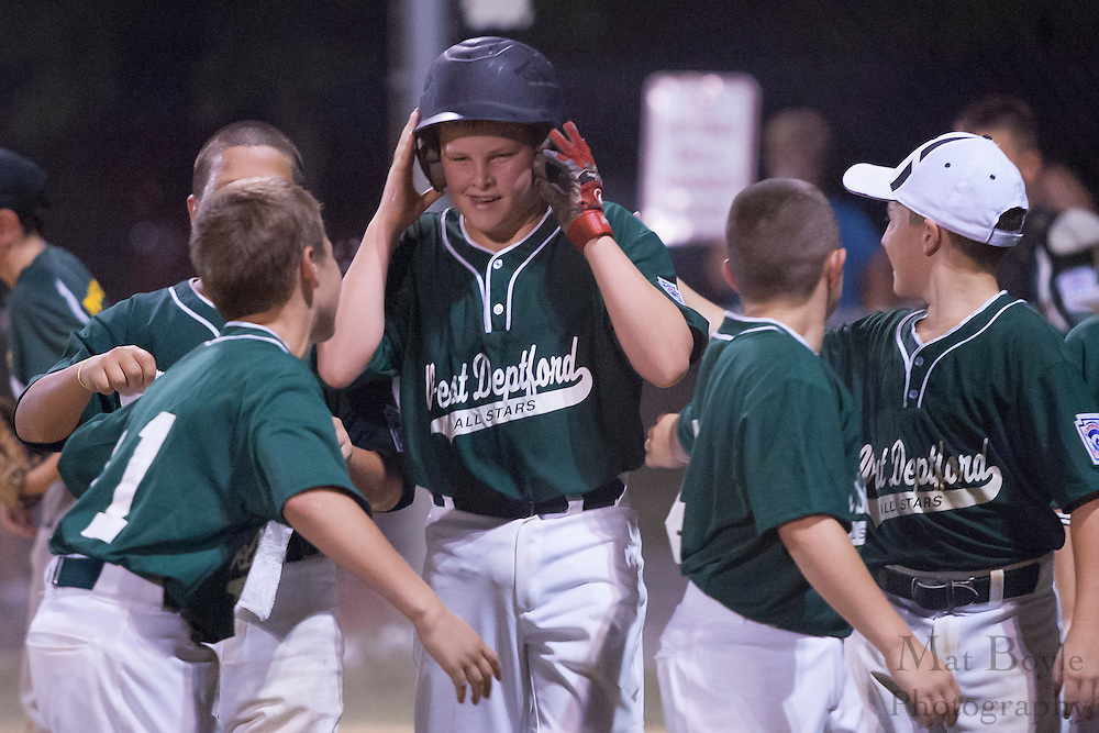 West Deptford's Kyle Magee is greeted by teammates after hitting a two run homerun in the 5th inning during a District 15 Little League 11 year old all-star game against National Park held in Deptford Friday July 22, 2011.