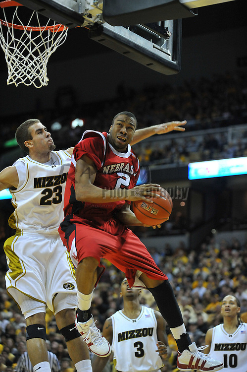 Jan 23, 2010; Columbia, MO, USA; Missouri Tigers forward Justin Safford (23) provides defense as Nebraska Cornhuskers guard Myles Holley (2) goes up for a shot in the first half at Mizzou Arena in Columbia, MO. Missouri won 70-53. Mandatory Credit: Denny Medley-US PRESSWIRE