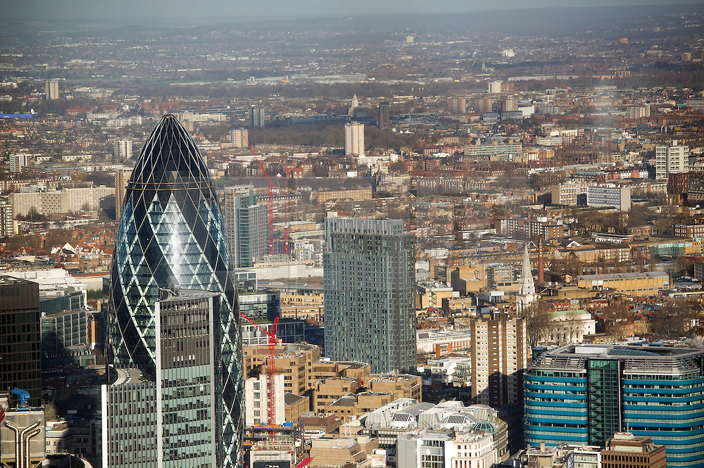 © London News Pictures. 09/01/2013 . London, UK.  A view from The Shard building in London over London City centre showing 30 St Mary Axe (AKA The Gherkin, pictured left)  on Wednesday, Jan. 9, 2013. Photo credit : Ben Cawthra/LNP