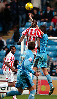Photo: Ed Godden.<br />Coventry City v Stoke City. Coca Cola Championship. 02/12/2006. Stoke's Mamady Sidibe wins the ball in the air.