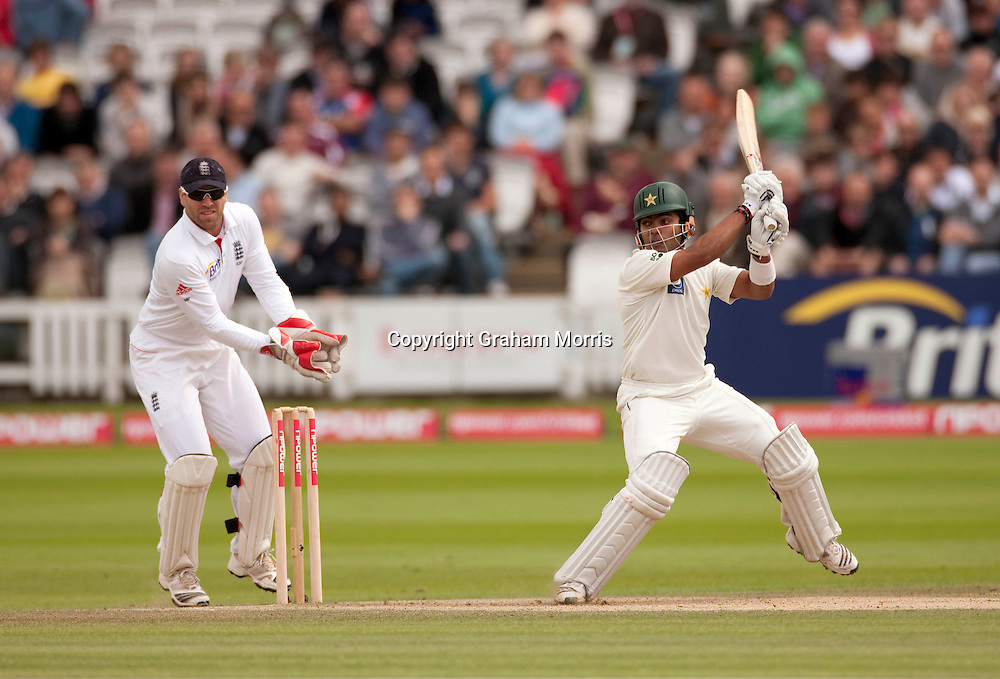Umar Akmal hits Graeme Swann for four during the final npower Test Match between England and Pakistan at Lord's.  Photo: Graham Morris (Tel: +44(0)20 8969 4192 Email: sales@cricketpix.com) 29/08/10
