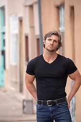 hot guy in a town looking off
