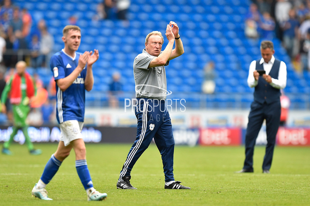 Cardiff City manager Neil Warnock applauds the fans at full time after the 1-0 win over Middlesbrough during the EFL Sky Bet Championship match between Cardiff City and Middlesbrough at the Cardiff City Stadium, Cardiff, Wales on 21 September 2019.