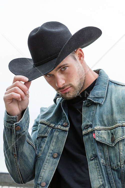 portrait of a hot cowboy with green eyes