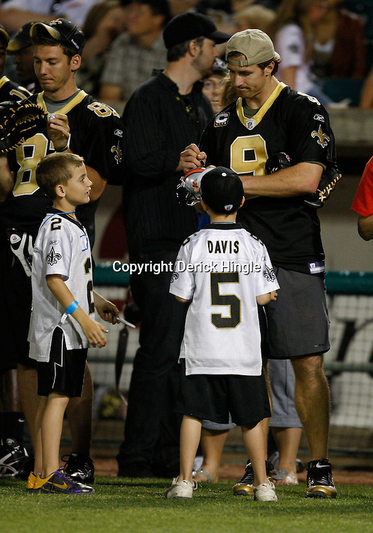 Apr 28, 2010; Metairie, LA, USA; Drew Brees (9) signs autographs for fans during the Heath Evans Foundation charity softball game featuring teammates of the Super Bowl XLIV Champion New Orleans Saints at Zephyrs Field.  Mandatory Credit: Derick E. Hingle-US-PRESSWIRE.