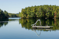 A raft and slide sit idle on Squam Lake as the lake traffic winds down.  (Karen Bobotas/for the Laconia Daily Sun)
