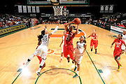 February 13, 2014: Alyssa Thomas #25 of Maryland shoots past Suriya McGuire #33 and Krystal Saunders #12 of Miami during the NCAA basketball game between the Miami Hurricanes and the Maryland Terrapins at the Bank United Center in Coral Gables, FL. The Terrapins defeated the Hurricanes 67-52.