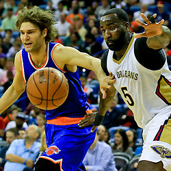 Mar 28, 2016; New Orleans, LA, USA; The ball is knocked away from New York Knicks center Robin Lopez (8) as New Orleans Pelicans center Kendrick Perkins (5) defends during the second quarter of a game at the Smoothie King Center. Mandatory Credit: Derick E. Hingle-USA TODAY Sports