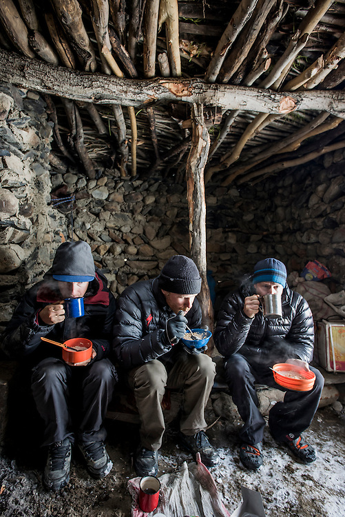 Huddling in a shepherds hut at the 4300m Karabel camp, a semi-nomadic shepherd outpost. Although our expedition was in the summer month of June, a blizzard pinned us down here for a day.