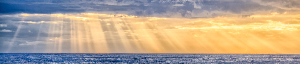Sun rays breaking through a stormy sky over the beach on the Outer Banks.