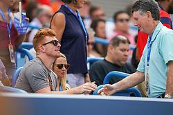 August 19, 2018 - Cincinnati, OH, U.S. - CINCINNATI, OH - AUGUST 19: Andy Dalton, quarterback of the Cincinnati Bengals, shakes hands with Bill Cunningham, radio talk show host for 700 WLW, during the match between Simona Halep of Romania (not pictured) and Kiki Bertens of the Netherlands (not pictured) during the Western & Southern Open singles final at the Lindner Family Tennis Center in Mason, Ohio on August 19, 2018. (Photo by Adam Lacy/Icon Sportswire) (Credit Image: © Adam Lacy/Icon SMI via ZUMA Press)