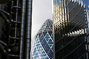 City of London landmarks Swiss Re Building seen between The Lloyds Building and The Willis Building, England, UK