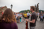 "Audience listening to the ""Electroshock""  electric swing quartet performing at Charles Bridge. Every artist working on Charles Bridge had to go through a selection process in front of a jury to get permission to work on the bridge."