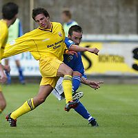 Montrose v St Johnstone....10.07.04<br />Trialist Mark Robinson is tackled by Evan Hall<br /><br />Picture by Graeme Hart.<br />Copyright Perthshire Picture Agency<br />Tel: 01738 623350  Mobile: 07990 594431