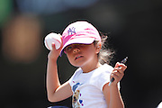 ANAHEIM, CA - JUNE 05:  A young female fan holds up a ball with the hope of getting an autograph at the Los Angeles Angels of Anaheim game against the New York Yankees on June 5, 2011 at Angel Stadium in Anaheim, California. The Yankees won the game 5-3. (Photo by Paul Spinelli/MLB Photos via Getty Images)