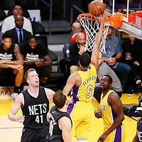 15 November 2016: Los Angeles Lakers guard Jordan Clarkson (6) goes for the layup past Brooklyn Nets guard Bojan Bogdanovic (44) and Brooklyn Nets center Justin Hamilton (41) during the LA Lakers 125-118 victory over the Brooklyn Nets, at the Staples Center, Los Angeles, California, USA.