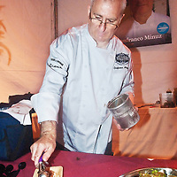 "Executive Chef From Lago, Gianfranco Minuz prepares Sorgetto di Melanzane Con Ricotta  Condita (Housemade Market Eggplant Sorbet, Freshly Seasoned Ricotta , Red Onion, Pinenut and Golden Raisin Saute) during  Los Angeles Food & Wine Festival's ""Summer at the Shore,"" at the Fairmont Miramar Hotel & Bungalows on Friday, Aug  10, 2012."