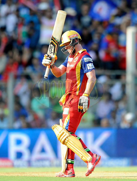 AB De Villiers of Royal Challengers Bangalore acknowledges teammate after scoring a half century during match 46 of the Pepsi IPL 2015 (Indian Premier League) between The Mumbai Indians and The Royal Challengers Bangalore held at the Wankhede Stadium in Mumbai, India on the 10th May 2015.<br /> <br /> Photo by:  Pal Pillai / SPORTZPICS / IPL