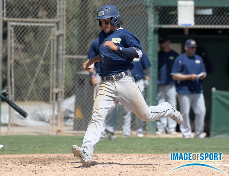 Cal State Monterey Bay Otters third baseman Ruben Gonzalez (4) crosses home plate to score during an NCAA College baseball game against the Cal  Poly Pomona Broncos in Pomona, Calif., Friday, April 13, 2018.