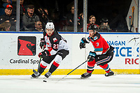 KELOWNA, BC - NOVEMBER 1:  Sean Comrie #3 of the Kelowna Rockets stick checks Filip Koffer #23 of the Prince George Cougars as he skates with the puck at Prospera Place on November 1, 2019 in Kelowna, Canada. (Photo by Marissa Baecker/Shoot the Breeze)