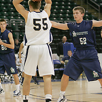 Center Mitch Wilfer (55) looks to move the ball around forward Matt Hink (52)