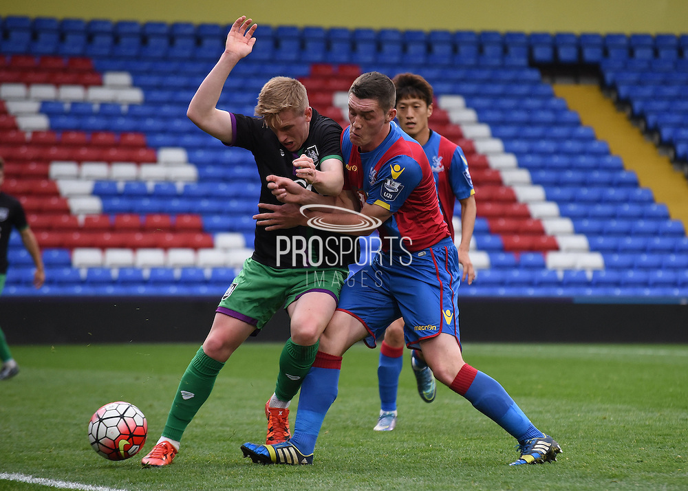 Connor Dymond with the challenge during the Final Third Development League match between U21 Crystal Palace and U21 Bristol City at Selhurst Park, London, England on 3 November 2015. Photo by Michael Hulf.
