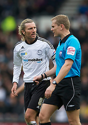 DERBY, ENGLAND - Saturday, March 12, 2011: Derby County's Robbie Savage argues with referee Graham Scott during the Football League Championship match against Swansea City at Pride Park. (Photo by David Rawcliffe/Propaganda)