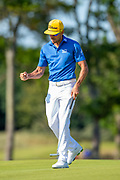 Benjamin Hebert (FRA) punches the air as he makes par on the 9th green during the final round of the Aberdeen Standard Investments Scottish Open at The Renaissance Club, North Berwick, Scotland on 14 July 2019.