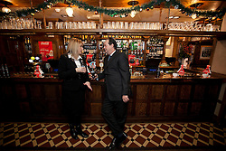 © Licensed to London News Pictures. 06/12/2012. London, UK. Road Safety Minister, Stephen Hammond, chats with Coca Cola representative Kerry Roberts at the launch of the 2012 Designated Drivers Campaign in the Mason's Arms Pub in London today (06/12/12). The campaign, aimed at providing free non-alcoholic drinks for designated drivers, is sponsored by soft drinks company Coca Cola and runs from 6-31 December 2012.    Photo credit: Matt Cetti-Roberts/LNP