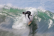 EL PORTO, MANHATTAN BEACH, CALIFORNIA, USA - OCTOBER 1. Surfers enjoy large waves on October 1, 2012. El Porto is a popular beach with surfers because of an underwater canyon that creates large waves.