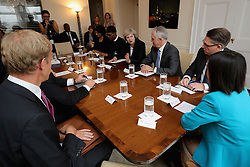 Prime Minister Theresa May heads a round table discussion on modern slavery with world leaders, including President of Nigeria Muhammadu Buhariat (left) and Australian Prime Minister Malcolm Turnbull (right) at the UK's permanent representatives residence in New York City.