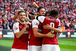 Sead Kolasinac, Olivier Giroud and Alexandre Lacazette of Arsenal celebrate after winning the penalty shootout to lift the Community Shield - Rogan Thomson/JMP - 06/08/2017 - FOOTBALL - Wembley Stadium - London, England - Arsenal v Chelsea - FA Community Shield.
