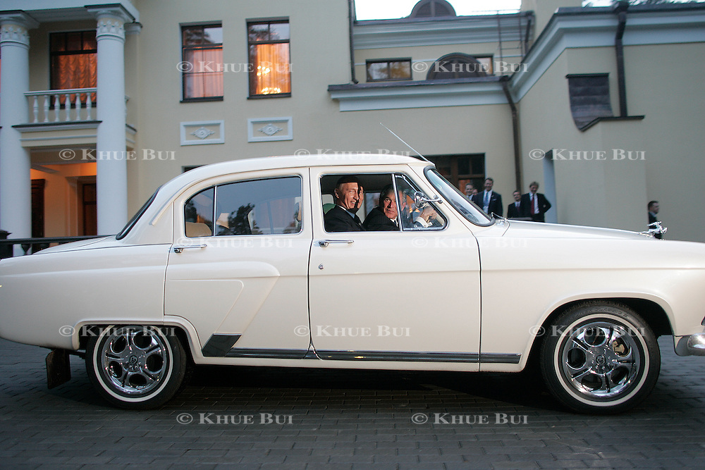 US President George W. Bush and the President of Russia Vladimir Putin drive around the Presidential Residence in Putin's 1956 Volga Sunday, May 8, 2005, in Novo Ogarevo, Russia...Photo by Khue Bui