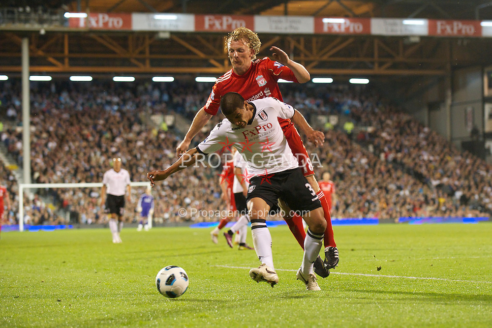 LONDON, ENGLAND - Monday, May 9, 2011: Liverpool's Dirk Kuyt in action against Fulham's Carlos Salcido during the Premiership match at Craven Cottage. (Photo by David Rawcliffe/Propaganda)