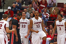 Feb 16, 2012; Stanford CA, USA; Stanford Cardinal forward/center Josh Owens (13) celebrates after a play against the Oregon State Beavers during the second half at Maples Pavilion. Stanford defeated Oregon State 87-82. Mandatory Credit: Jason O. Watson-US PRESSWIRE