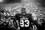 Indiana Hoosiers defensive lineman Ralph Green III (93) celebrates winning the Old Brass Spittoon from Michigan State after an NCCA college football game in Bloomington, Ind., Saturday, Oct. 1, 2016.