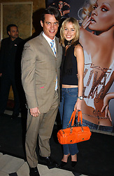 MATTHEW MELLON and NOELLE RENO at a party to celebrate Pamela Anderson's new role as spokesperson and newest face of the MAC Aids Fund's Viva Glam V Campaign held at Home House, Portman Square, London on 21st April 2005.<br />