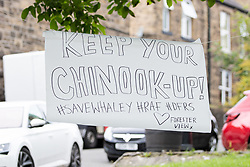 "© Licensed to London News Pictures. 04/08/2019. Whaley Bridge, UK. Poster reading "" Keep your chinook up "" . Residents just outside the cordon erect signs thanking emergency services . Further homes have been evacuated overnight and more rain is forecast today (Sunday 4th August) in the town of Whaley Bridge in Derbyshire after earlier heavy rain caused damage to the Toddbrook Reservoir , threatening homes and businesses with flooding. Photo credit: Joel Goodman/LNP"