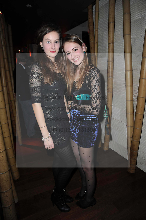 Left to right, LADY LUCIA ST CLAIR ERSKINE and RUBY WEATHERALL at the Tatler Little Black Book Party held at Chinawhite, 4 Winsley Street, London on 20th November 2009.