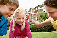 Children Looking at Snake in Jar