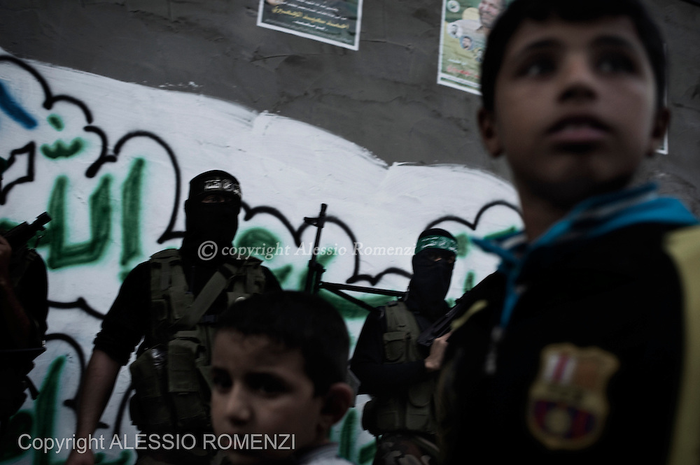 Gaza City: Gunmen from the Ezzedine al-Qassam Brigades, the armed wing of Hamas, line up outside the house of their late leader Ahmed Jaabari, as mourners visit his family to pay their condolences. November 22, 2012. ALESSIO ROMENZI
