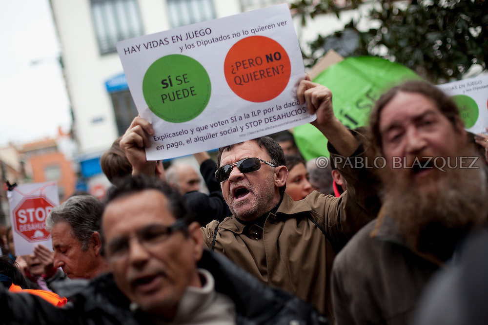 Anti-eviction activists demonstrate claiming the vote for a Popular Legistative Initiative (ILP) to stop evictions, regulate dation in payment and social rent outside the Municipal Building of Vallecas, which is office of Popular Party (PP) deputy Eva Duran, on April 3, 2013 in Madrid, Spain. Placard reads 'Yes we can, but they don't want'. The Mortgage Holders Platform (PAH) and other anti evictions organizations are organizing 'escraches' since several weeks ago outside Popular Party deputies houses and offices.